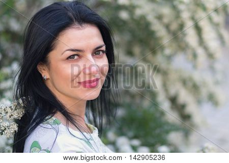 Portrait of a beautiful woman with green eyes. People