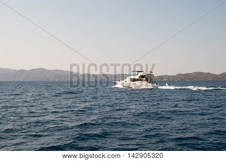 Selimiye Turkey; 14 August 2015: Speed yatch crusing on the sea Turkey