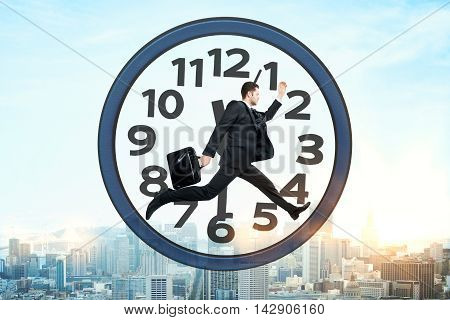 Businessman with briefcase running inside clock on city background. Time management concept