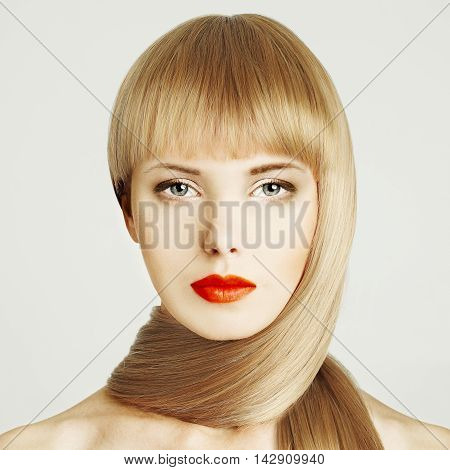 Blond hair. Beautiful woman face with make-up