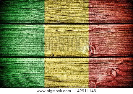 flag of Mali painted on old grungy wooden background:3d illustration