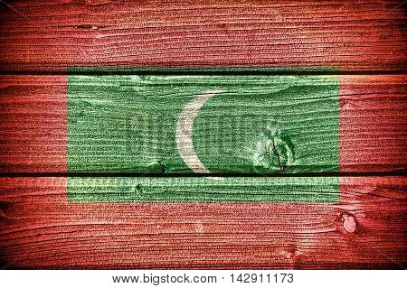 Flag of the Maldives painted on old grungy wooden background: 3d illustration