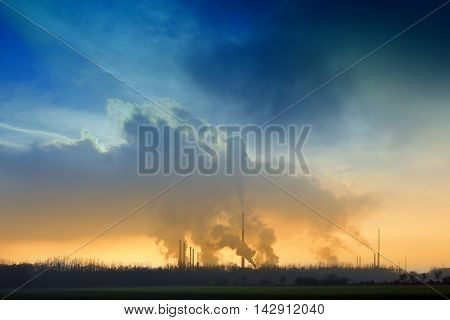 Factory blue clouds evening time, which pollutes the environment