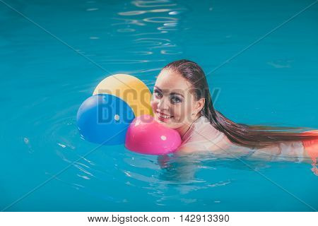 Happy Woman In Water Having Fun With Balloons