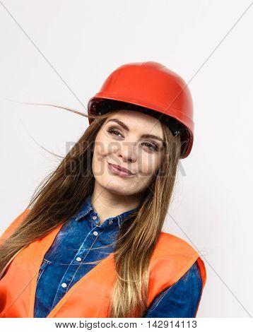 Woman Engineer Construction Builder In Helmet.