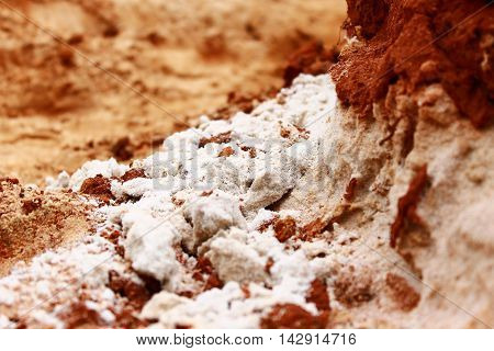 White silica sand in contrast with the red clay