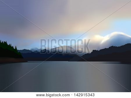 A beautiful sunrise over a calm, tranquil, misty mountain lake.