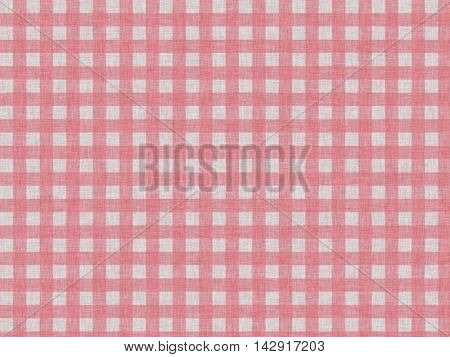 Red checkered pattern in the form of a cell in a simple printed cotton fabric