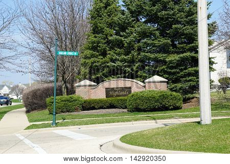 JOLIET, ILLINOIS / UNITED STATES - MAY 26, 2016: A sign marks the entrance to the Wesmere Highlands neighborhood of Joliet's Wesmere Country Club subdivision.