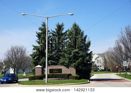 JOLIET, ILLINOIS / UNITED STATES - MAY 26, 2016: A sign marks the entrance to the Wesmere Arbor neighborhood of Joliet's Wesmere Country Club subdivision.