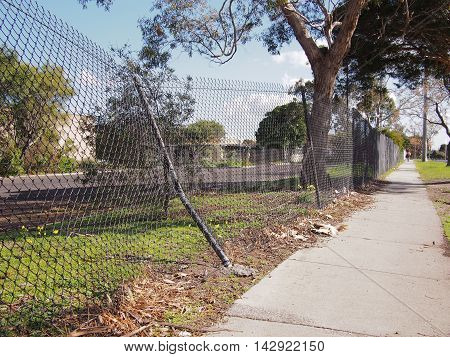 Damaged wire security fence after a car impact Melbourne 2016