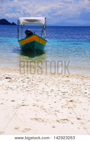 Boat harboring on the beaches of Perhentian island, Malaysia