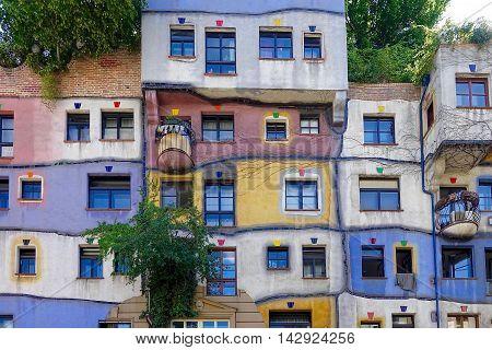 Vienna, Austria, August 2, 2016: A part of one face of the Hundertwasser house in Vienna, Austria.