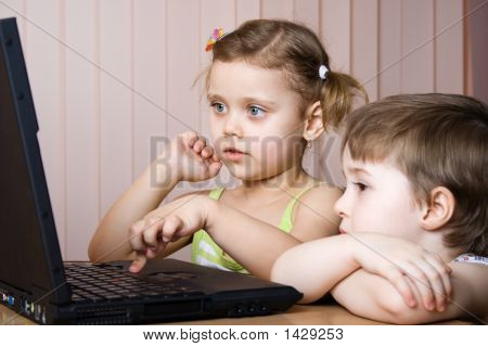 Sister And Brother Working With A Laptop