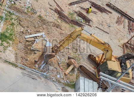 Excavator working.   destruction in Work outdoor construction :Top view