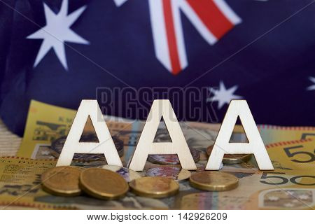Australian flag with three A's and money.