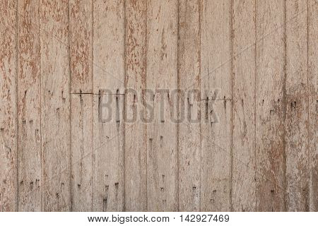 Wood Wooden texture background. The centuries-old house wall. traces of rust nail.