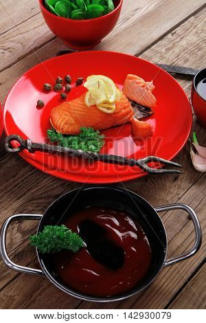delicious portion of fresh roast salmon fillet red plate green salad kale tomato soup bbq sauce black coffee wooden table - healthy food, diet cooking concept kale tomato soup bbq sauce black coffee