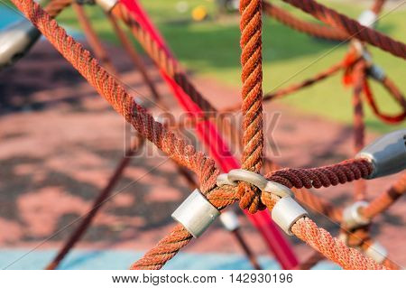 close up image of climbing net for children at the playground.it tied together securely.