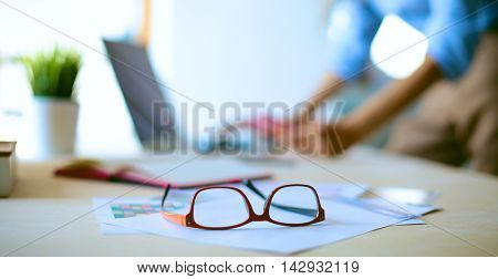 Young female businesswoman in the office