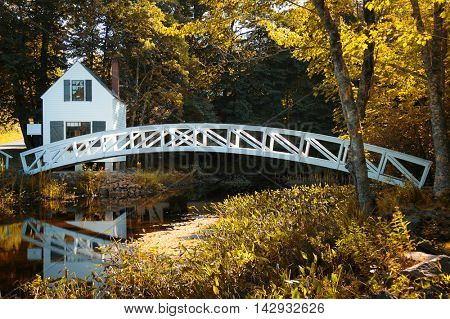 Little white house and wooden bridge at Somesville, Mount desert island, Maine, USA.