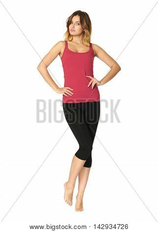 Healthy Teen In Black Tights Stands With Hands Isolated