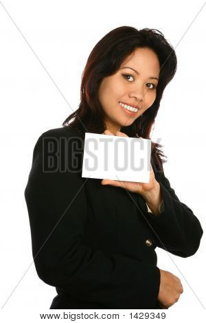 Asian Woman Holding A Piece Of White Card