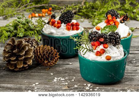 Beautiful Christmas Cupcake With Cream And Berry On Wooden Background Cinnamon Cones