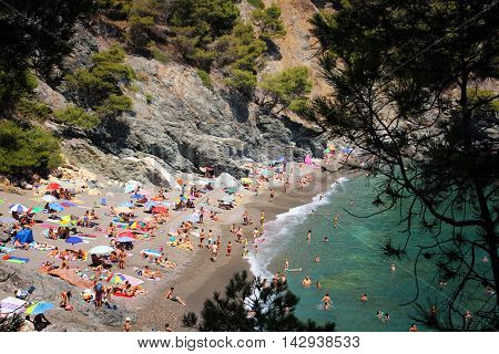 GIRONA/SPAIN - 13 AUGUST 2016: Loads of people enjoying the mid-august weekend in Cala Fonda near the village of Begur in Costa Brava