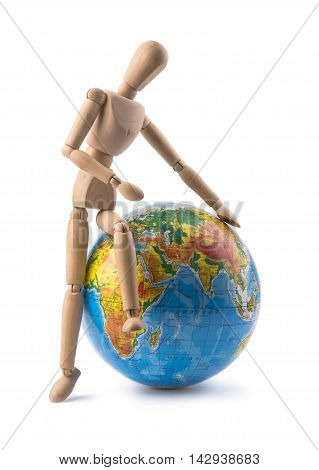 Figurine of a man trying to sit on globe