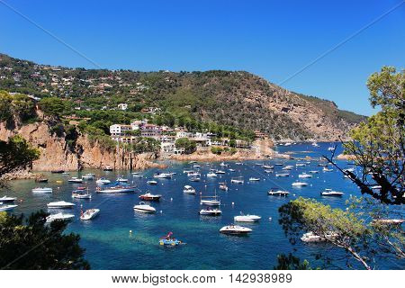 GIRONA/SPAIN - 13 AUGUST 2016: Loads of boats parked in a bay south of Begur in Costa Brava