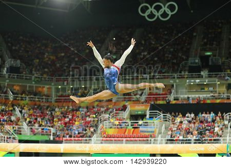 RIO DE JANEIRO, BRAZIL - AUGUST 8, 2016: Olympic champion Simone Biles of United States competing on the balance beam at women's all-around gymnastics at Rio 2016 Olympic Games