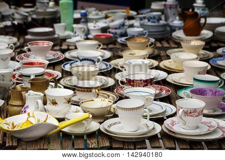 decorated coffee mugs made of fine china porcelain also called collectors' cups for sale at a flea market selected focus narrow depth of field