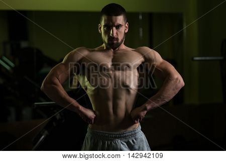 Healthy Young Man Flexing Muscles
