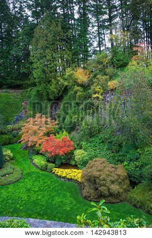 The world-famous masterpiece of park architecture. Butchart Gardens - beautiful gardens on Vancouver Island. Flower beds of colorful flowers and walking paths for tourists