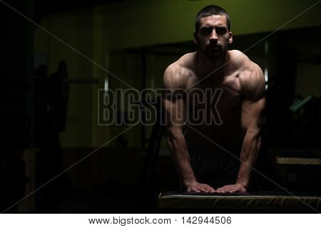 Push Ups On Bench In A Dark Room