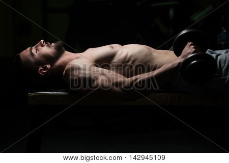 Man In The Gym Exercising Forearm With Dumbbells