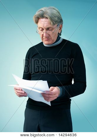 Senior man reading important papers