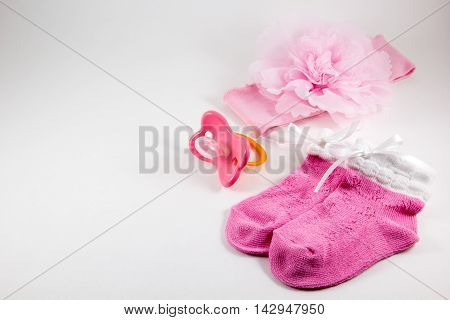 Bow booties and nipple on a white background