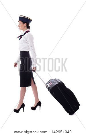 Side View Of Young Stewardess Walking With Suitcase Isolated On White