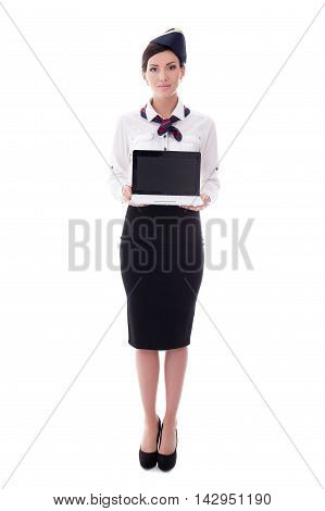 Portrait Of Young Stewardess Holding Laptop With Blank Screen Isolated On White