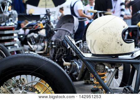 Old vintage motorcycle with chrome accents and helmet