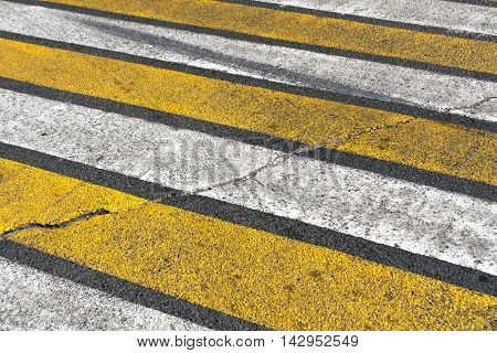 Old Damaged White And Yellow Zebra Pedestrian Crossing.