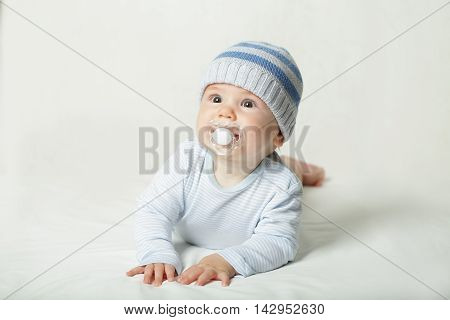 Cute child - baby with pacifier on background