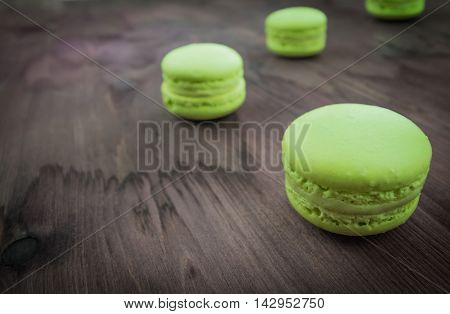 Green Cake Macaron On Wood Background, Maccarone Sweet Dessert