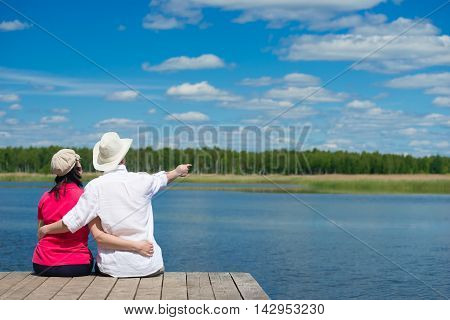 on the pier a couple of lovers regards nature