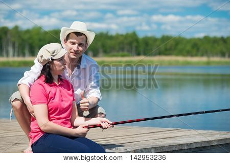 family on vacation fishing together with each other