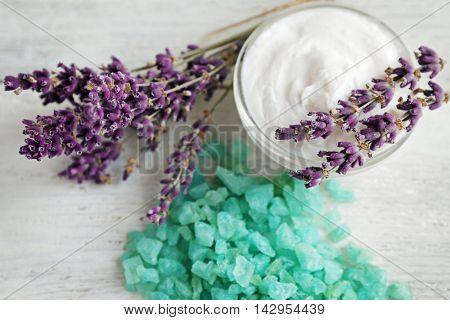 Spa composition with lavender and cream on white wooden background