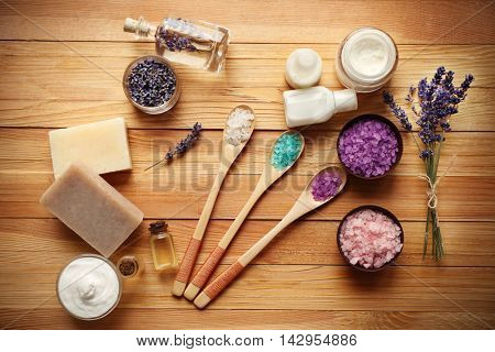 Spa composition with lavender and salt on wooden background