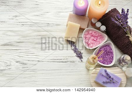 Spa composition with lavender and salt on white wooden background